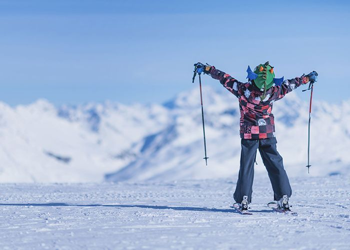 Happy child with equipment and clothing taken at Point rent a ski of Livigno